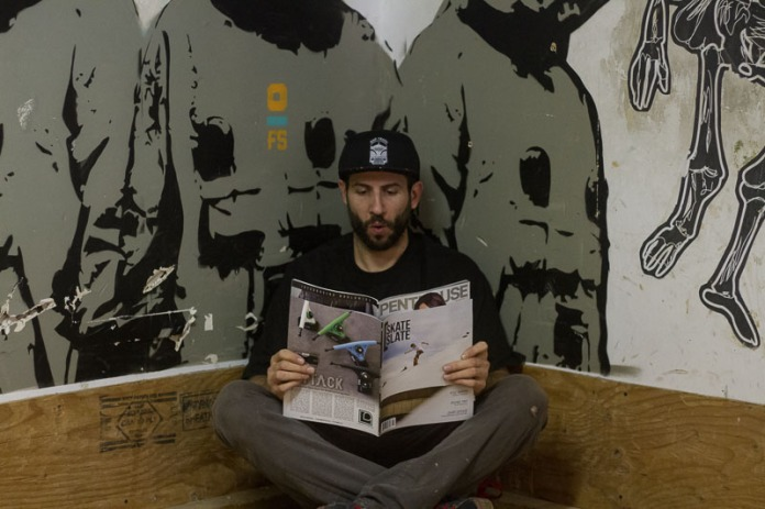 Checking out the latest issue at Flatspot Longboard Shop. Photo Aidan Lynds